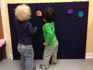 James and Adil working with the felt color circles.