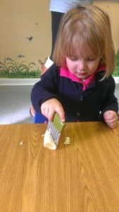 Livia chopping a banana