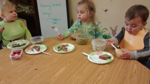 Toddlers Enjoying their Banana Bread